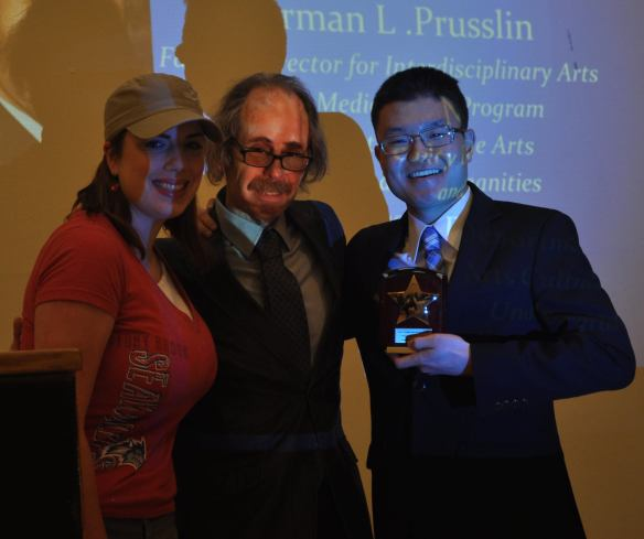 Norman L. Prusslin, Director of the Media Arts Minor at Stony Brook University, presents the Norman L. Prusslin Educational Media Program Award to SBU-SPJ. SBU-SPJ President  Jimin Kim and Vice President Kristy Gerlett accepted the award on behalf of their chapter.